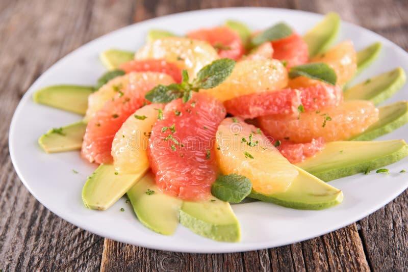Куски авокадоа и грейпфрута стоковая фотография