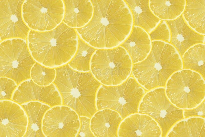 Куски свежего желтого лимона текстурируют предпосылку стоковая фотография