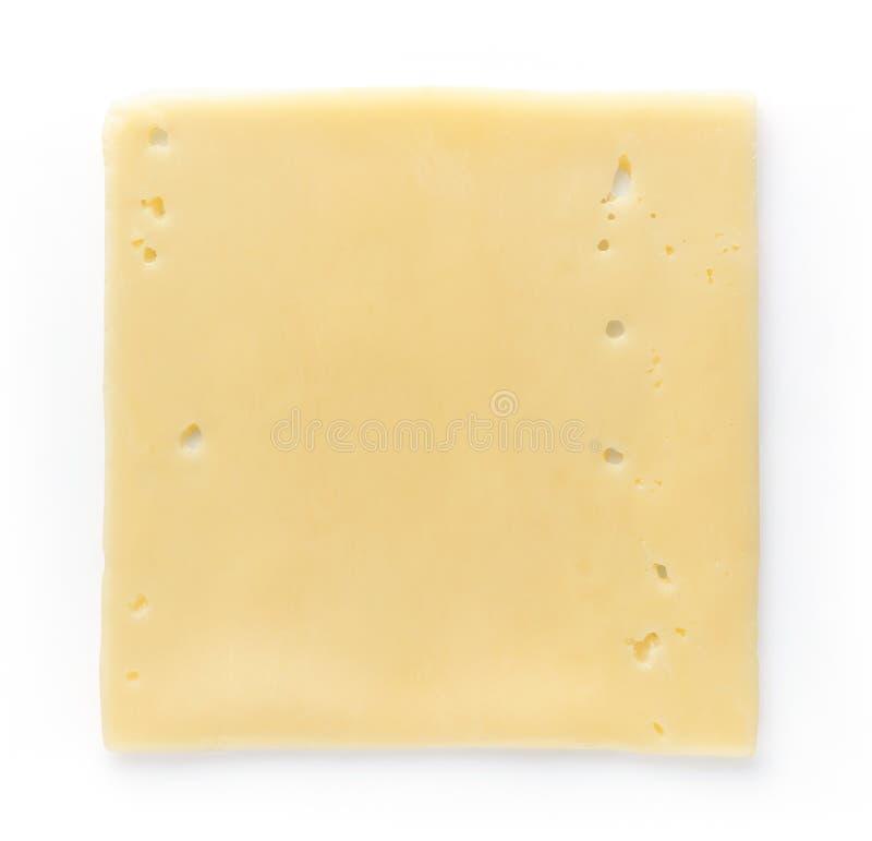 Куски сыра изолированные на белизне, сверху стоковое фото rf