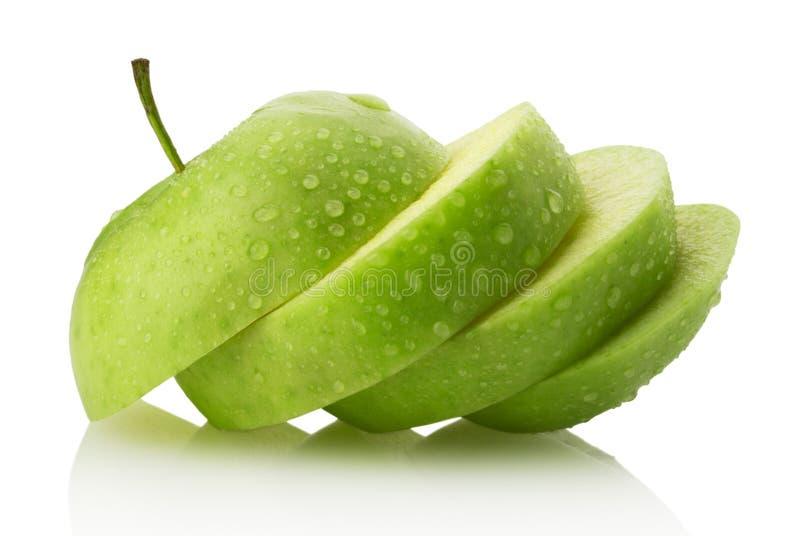 Куски Яблока на белой предпосылке стоковые фото