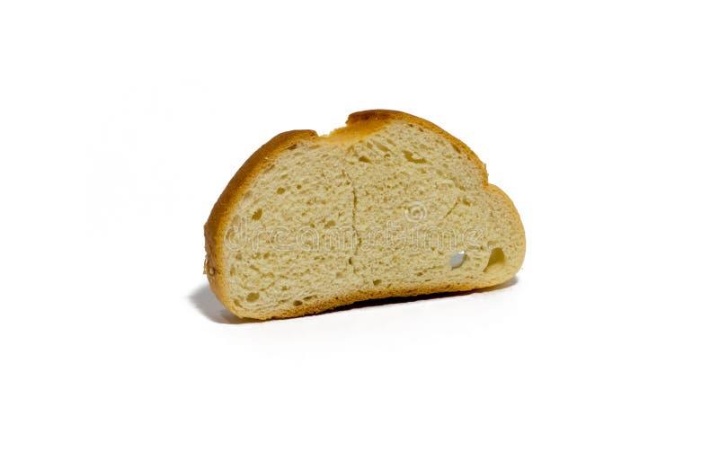 Кусок хлеба пшеницы изолированный на белизне еда, объект стоковое изображение