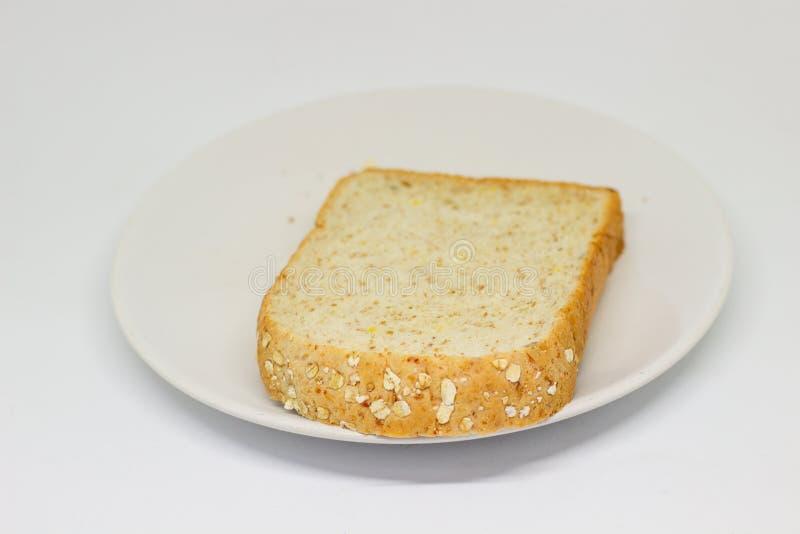 Кусок хлебов на белой предпосылке изолята диска стоковое фото