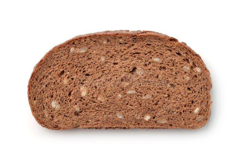 Кусок wholegrain хлеба рож с отрубями стоковое изображение
