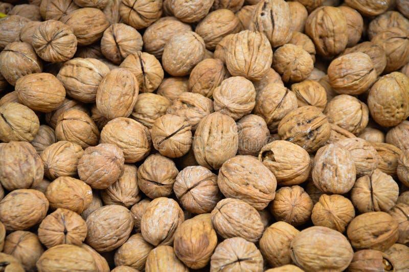 Куча грецких орехов стоковые фото
