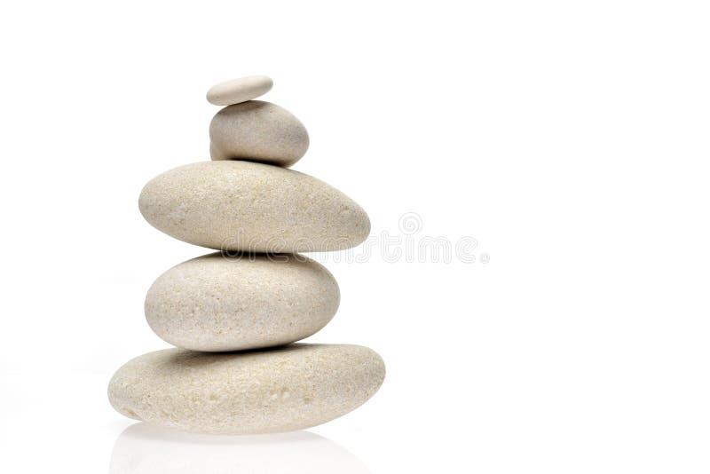 Куча камней изолированных на белой предпосылке стоковые фото