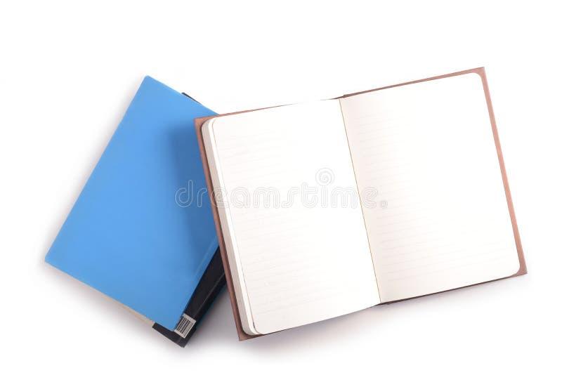 Куча книг и открытого блокнота стоковые изображения rf