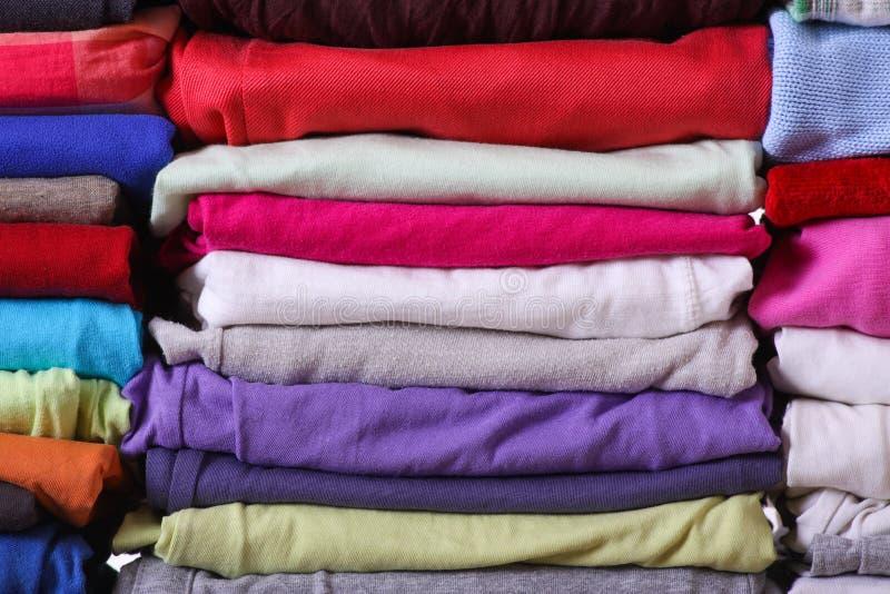 Куча красочных одежд стоковое фото rf