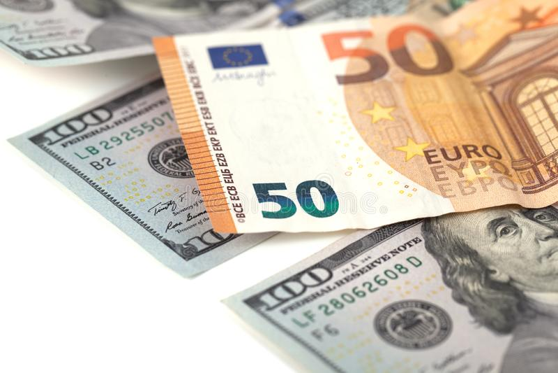 Куча мягких денег: доллары и евро стоковые фотографии rf