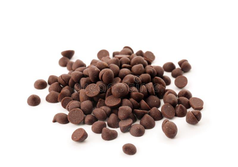 Куча очень вкусных темных обломоков шоколада стоковые изображения rf