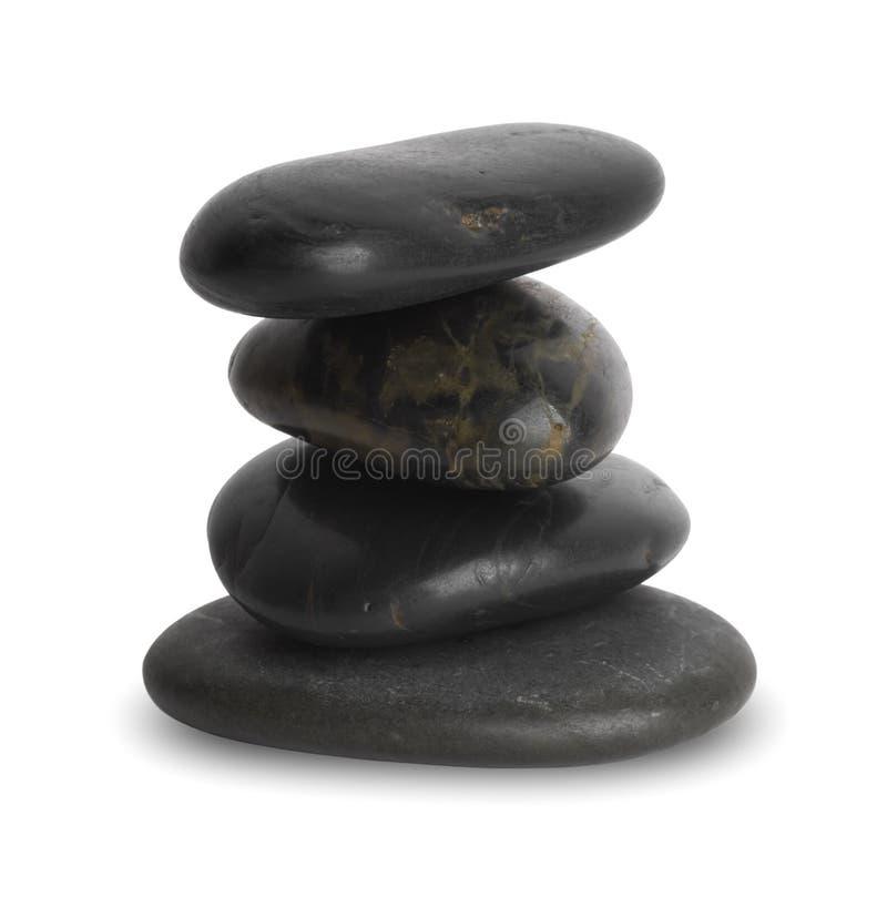 Куча 4 ровных черных камней камешка изолированных на белой предпосылке стоковое фото rf