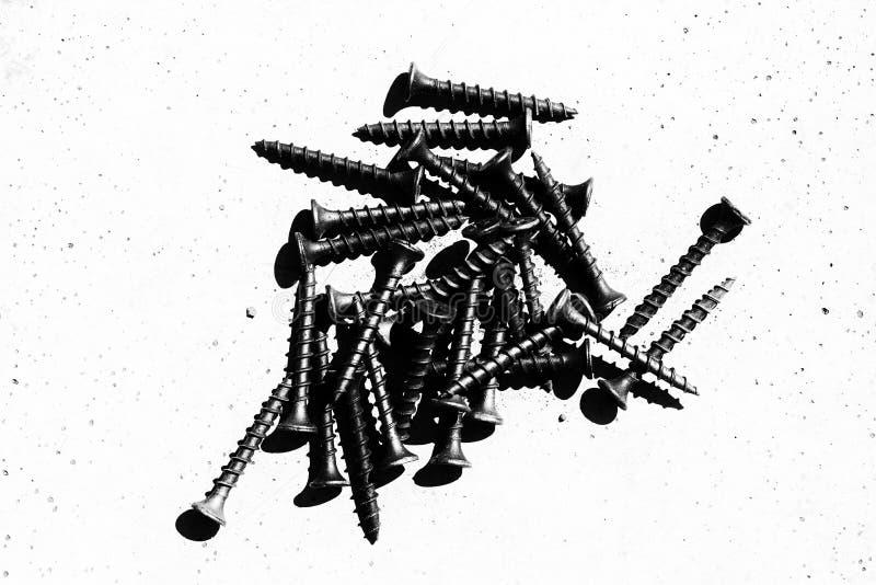 Куча черных деревянных винтов стоковое изображение rf