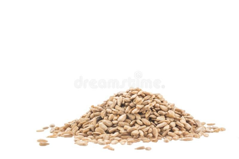 Куча черных семян подсолнуха изолированных на белизне стоковое фото rf