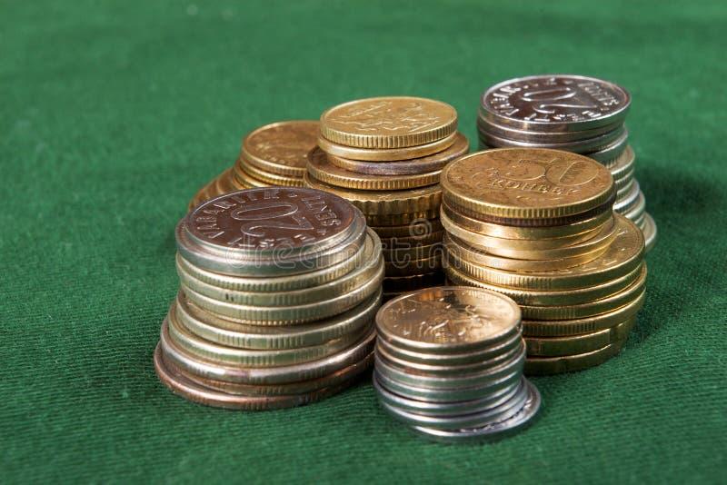 кучи монетки стоковая фотография