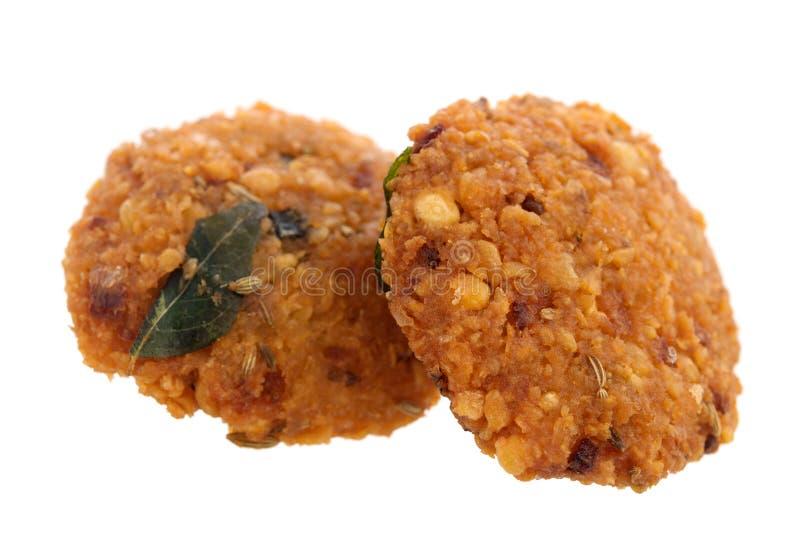 Кудрявые глубокие увольнянные закуски vadai стоковое фото rf