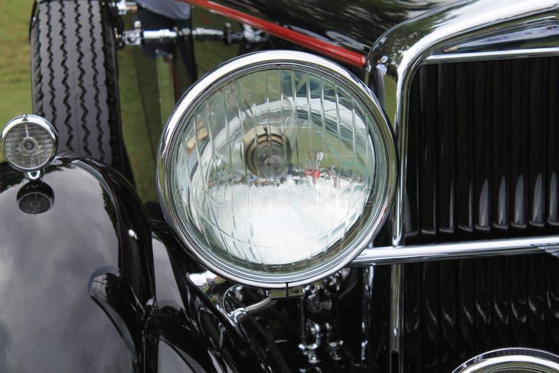 Классицистический американский headlamp год сбора винограда автомобиля стоковая фотография rf