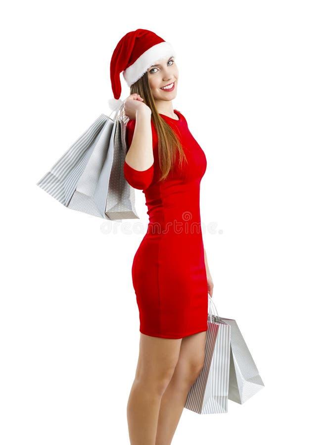 кладет женщину в мешки покупкы santa стоковое фото rf