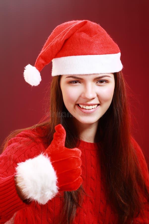 кладет женщину в мешки santa стоковая фотография