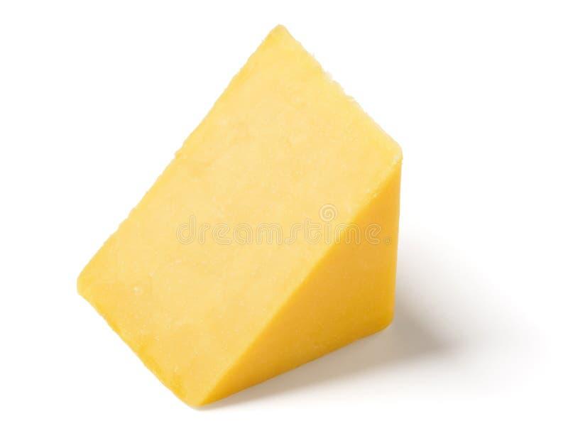 Клин сыра чеддера на белой предпосылке стоковое изображение rf