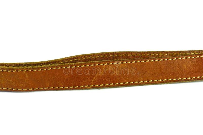 клиппирование коричневого цвета пояса предпосылки изолировало кожаную белизну путя стоковое изображение