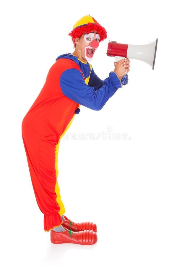 Клоун крича через мегафон стоковое фото rf