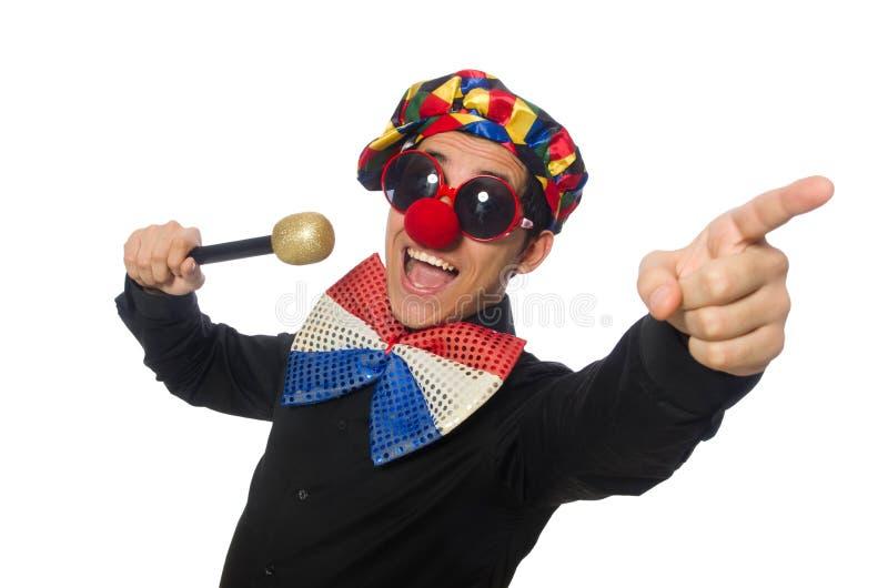 Клоун при микрофон изолированный на белизне стоковые изображения