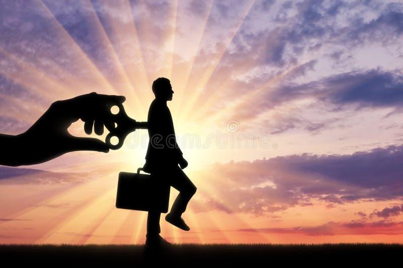 Ключ в руке босса, делает деятеля стоковая фотография