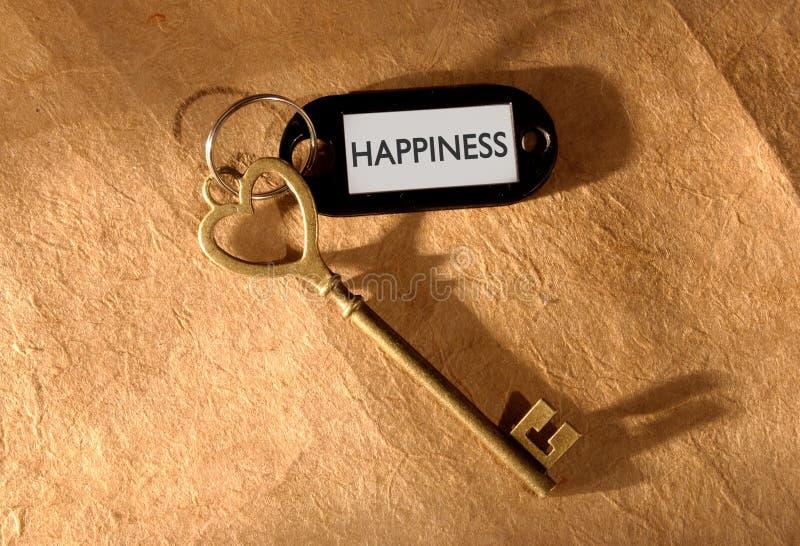 Ключ к счастью стоковые изображения