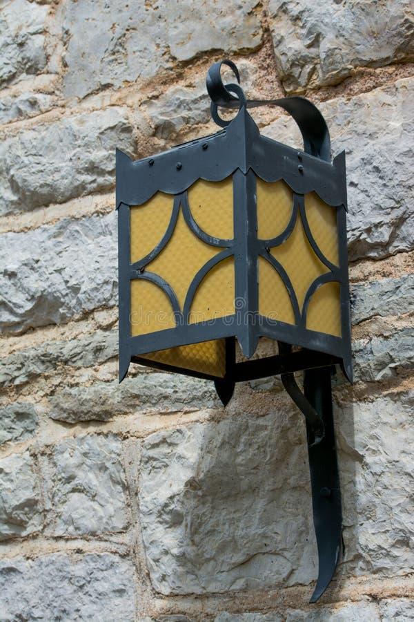 Лампа на камне стоковое фото