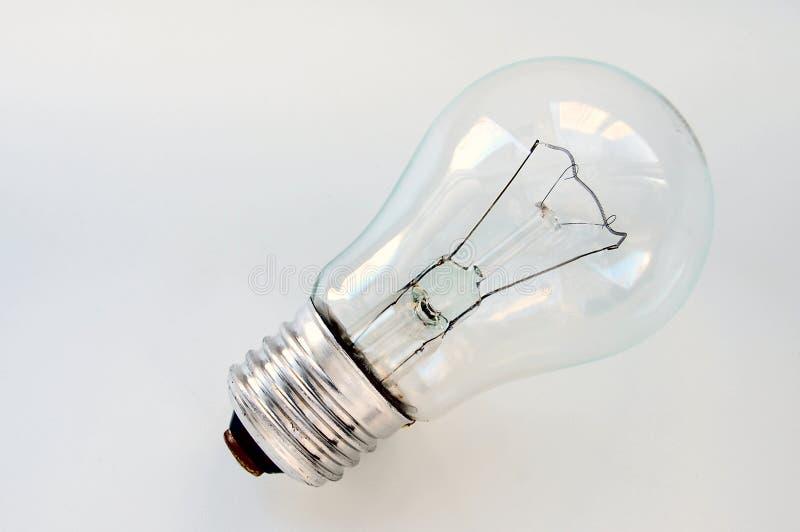 Лампа Ilyich или лампа накаливания на белой предпосылке стоковые фото
