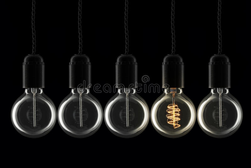 Лампочки нечетное одно вне стоковое фото
