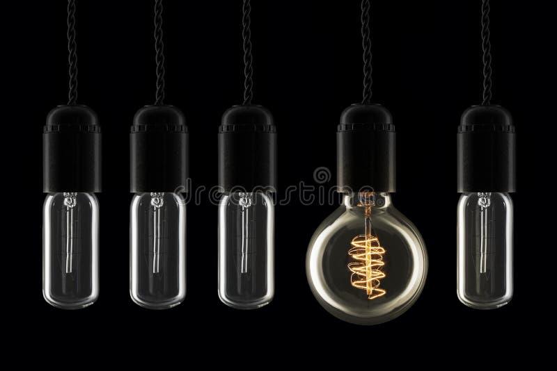 Лампочки нечетное одно вне стоковые изображения