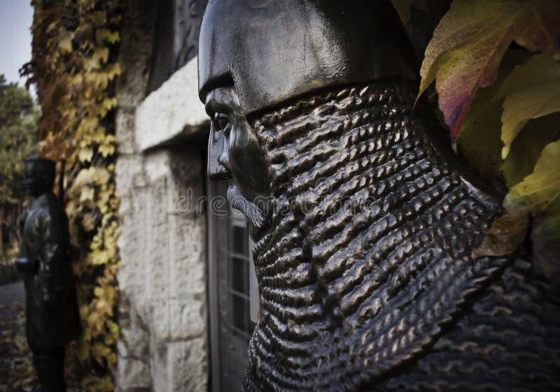 Латунная статуя рыцаря стоковое фото rf