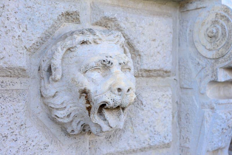 Лев Венеции, изваянная гравировка на стене Его можно использовать как предпосылка стоковые изображения