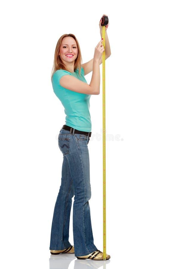 лента измерения девушки ся стоковое изображение rf