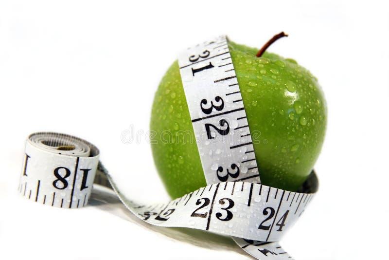 лента измерения яблока стоковая фотография rf