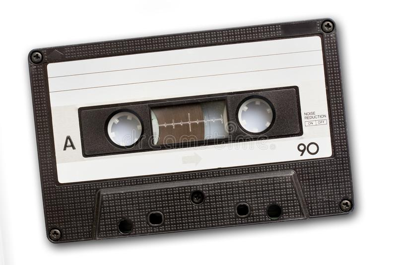 Лента магнитофонной кассеты изолированная на белой предпосылке, музыке ` s года сбора винограда 80 стоковые фотографии rf