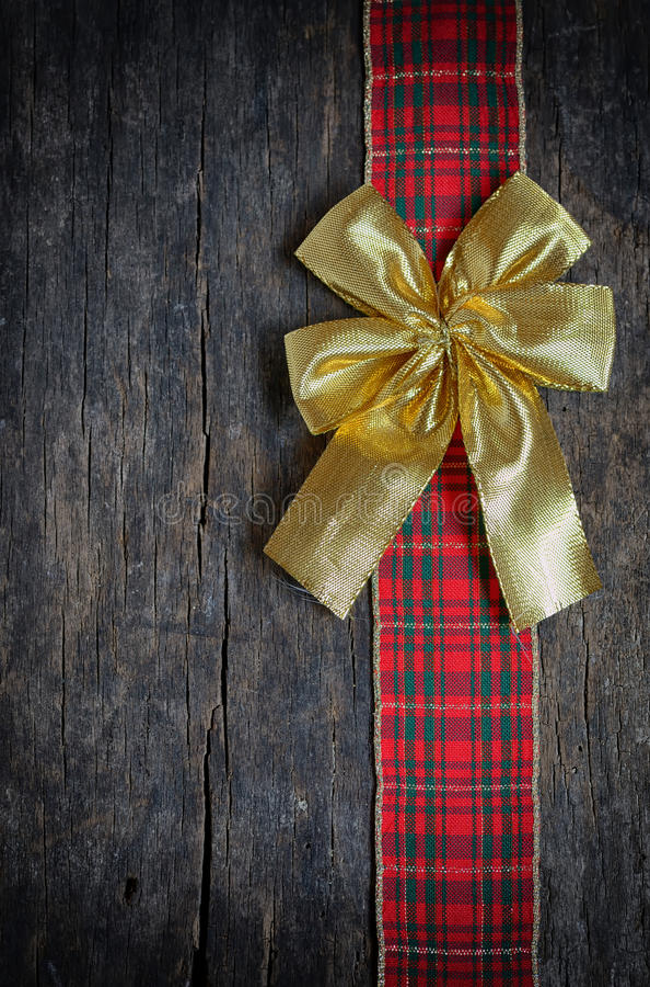 Лента рождества и золотой смычок подарка стоковое изображение