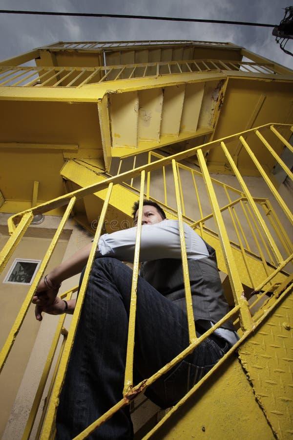 лестница человека сидя стоковые изображения