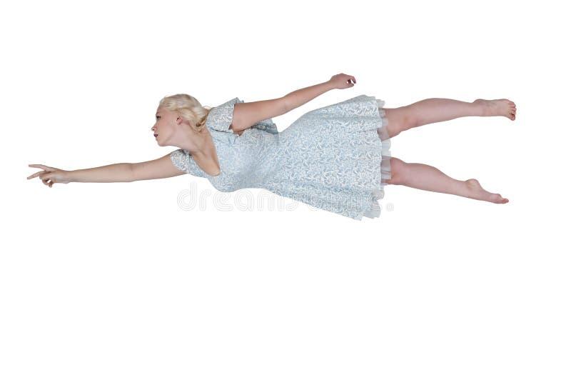 Летание женщины через небо стоковые фото