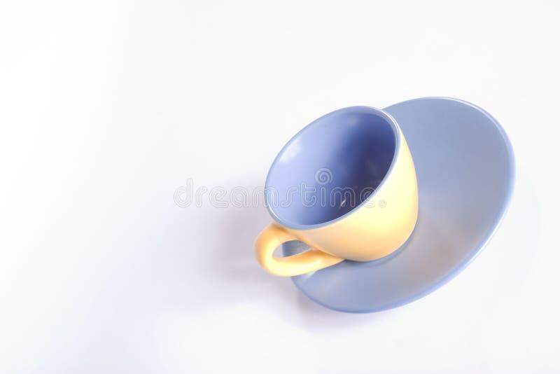 летание чашки стоковое изображение