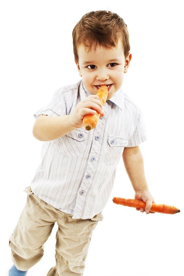лет еды моркови мальчика свежие старые 3 стоковая фотография
