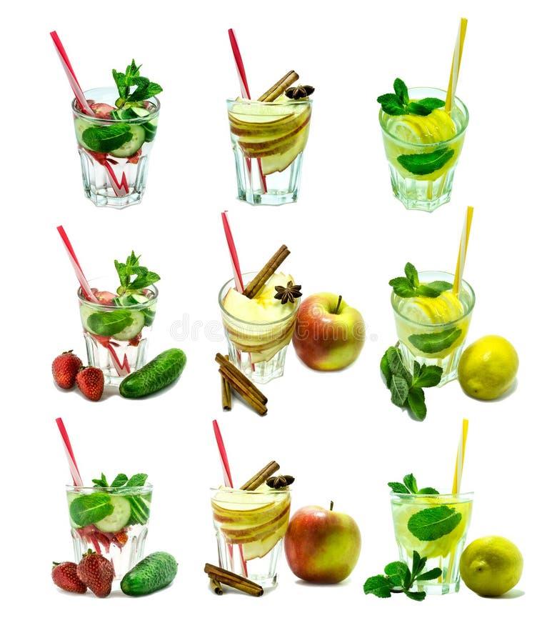 Лимон коктеиля воды вытрезвителя, мята, яблоко, клубника, огурец, циннамон изолированный на белой предпосылке стоковое изображение