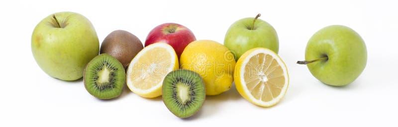 Лимон с яблоками и киви на белой предпосылке Киви с лимоном стоковое изображение rf