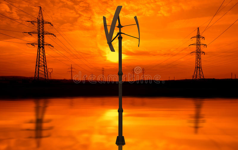 Линии электропередач, малая ветротурбина на заходе солнца стоковое фото rf