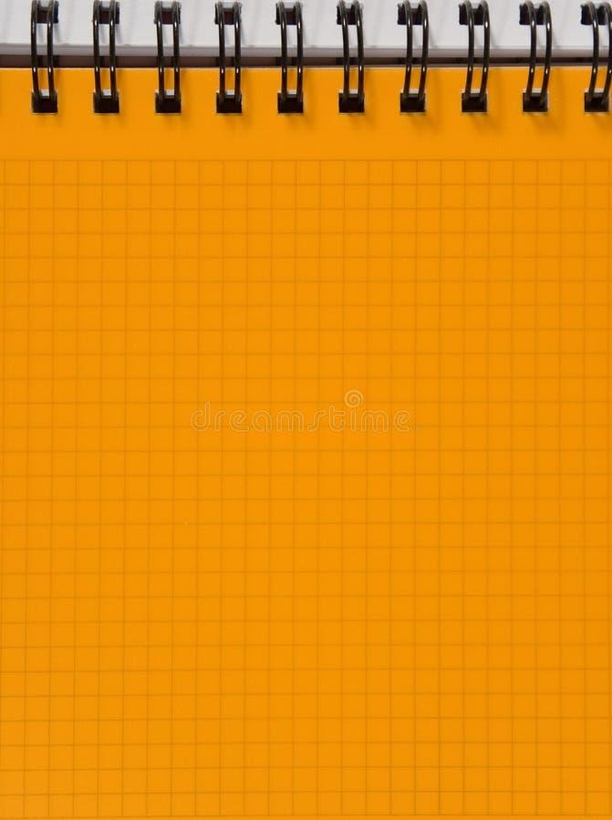 лист тетради придал квадратную форму желтому цвету стоковые фотографии rf