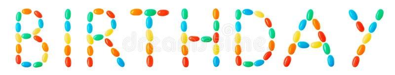 Литерность дня рождения сделанная из пестротканых конфет стоковые фотографии rf