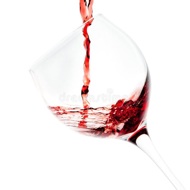 Лить красного вина стоковое фото