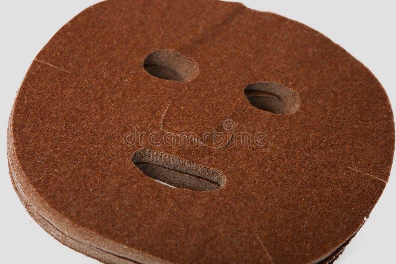 Лицевой щиток гермошлема от лотоса осеменяет естественные косметики на серой предпосылке стоковое фото rf