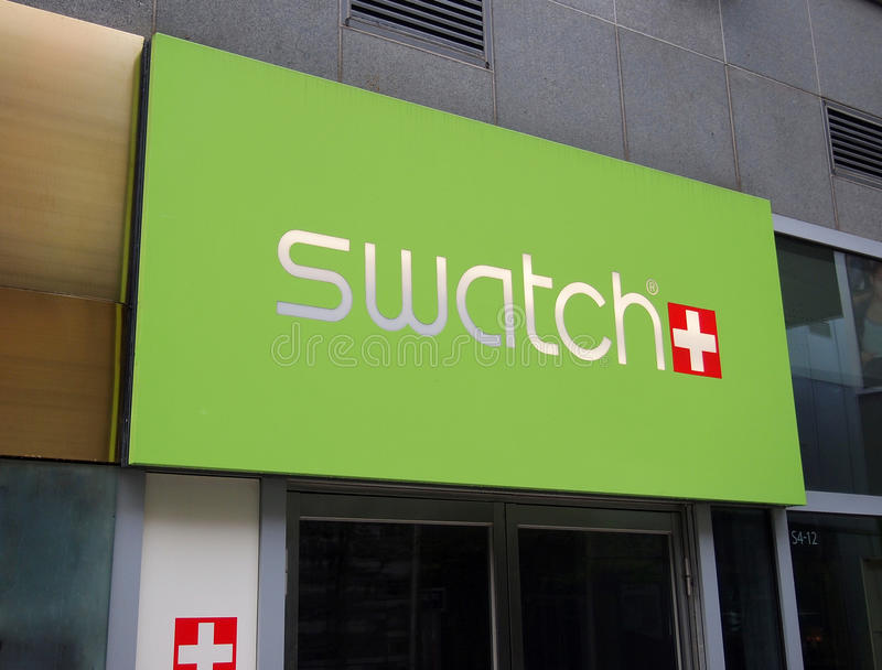 Логос Swatch на стене стоковое изображение rf