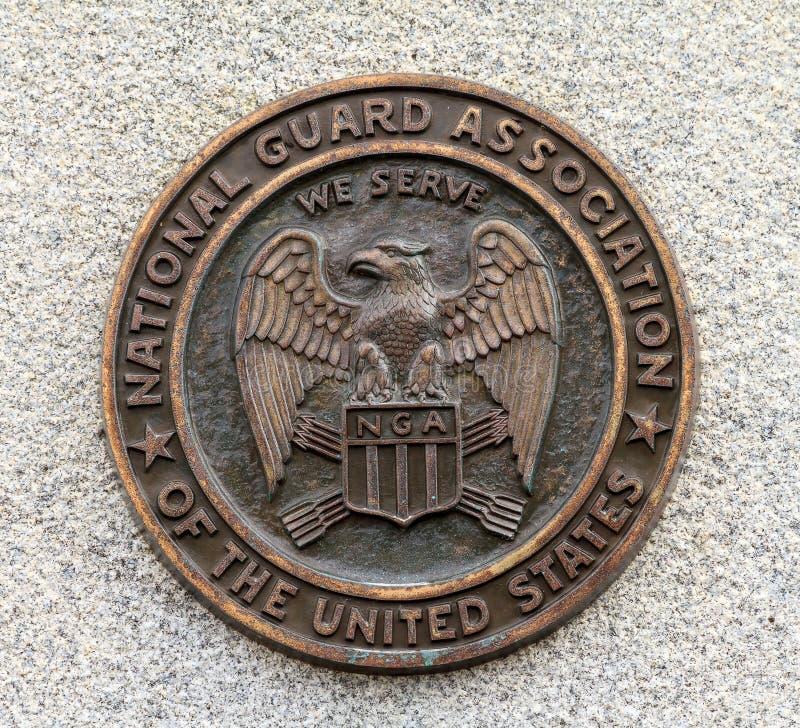 Логотип ассоциации национальной гвардии в бронзе стоковое изображение